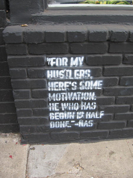 Stenciled on a wall. For my hustlers, here's some motivation. He who has begun is half done.