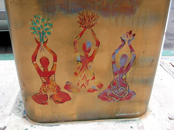 Three sitting female figures contain spiritual symbolism.