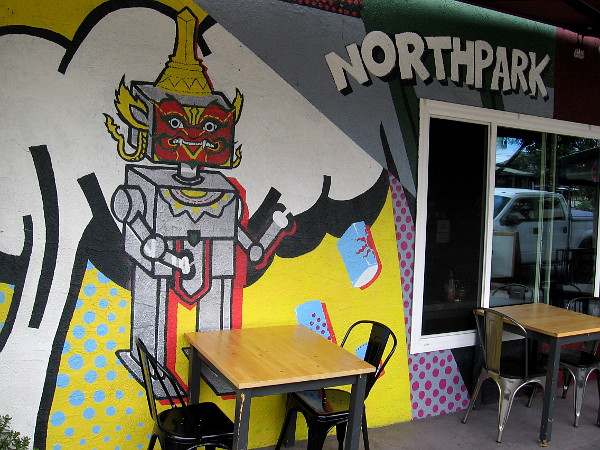 Fun robot graphic on the front wall of Soi 30th, a North Park Thai Eatery.