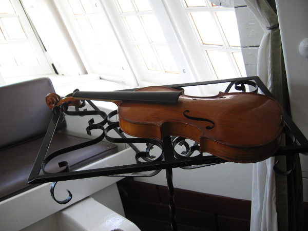 A violin on a stand. The favorite musical instrument of the fictional Captain Jack Aubrey.