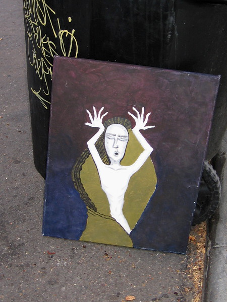 I spied this small work of art leaning up against a garbage can downtown.