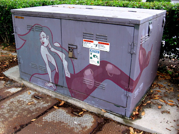 Another nearby transformer has been painted with a mermaid.