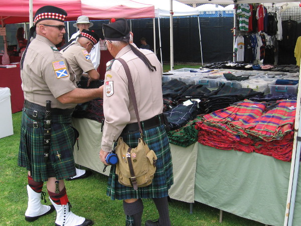 Gentlemen in kilts enjoy their Scottish heritage and each other's company.