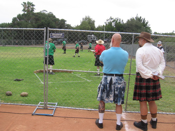 Strong athletes compete on the Brengle Terrace Park's baseball field. The Scottish Heavy Athletics include Weight Toss, Weight Throw, Hammer Throw, Braemar Stone and Caber Toss