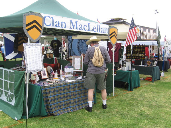 Not far away, someone checks out the tent of Clan MacLellan.