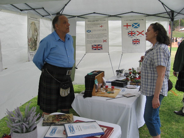Gentleman at the Scottish Plant Badge Society tents answers the question of a curious visitor.