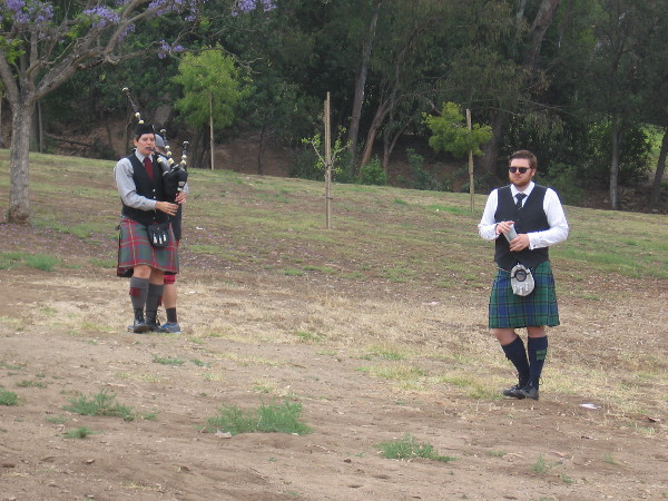 Someone stands in the distance practicing bagpipes. The distinctive sound could be heard all around the park!