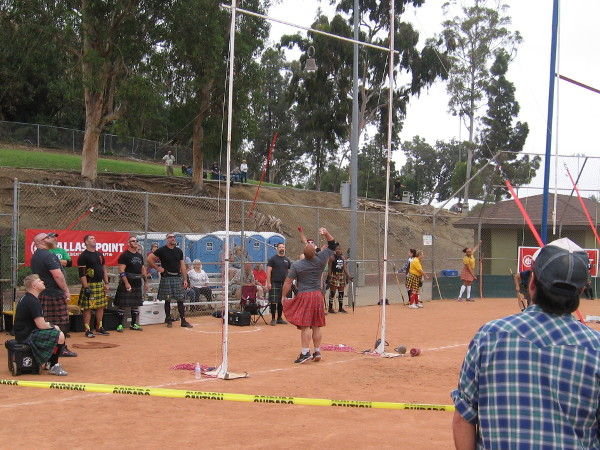 Back at the athletics competition, I saw men attempting to toss a 42 pound weight over a pole vault bar, and women doing the Sheaf Toss over a bar with a pitchfork.