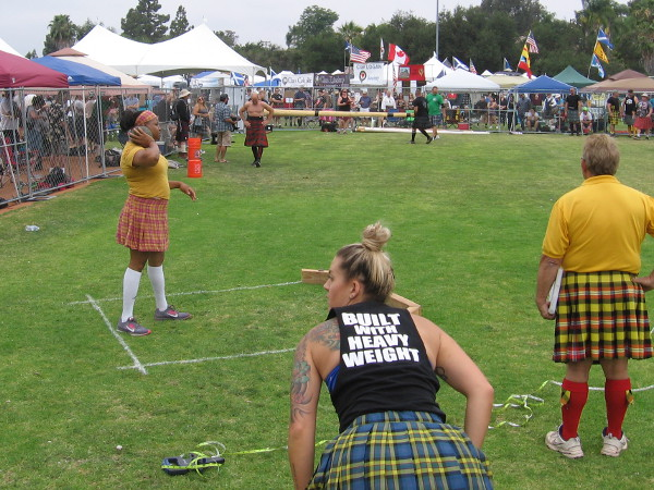 As women compete in the Braemer Stone Put, the Caber Toss competition is beginning!