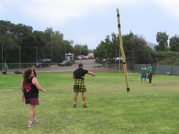 A caber goes flying. I saw one successful flip, but I don't recall which photo shows it.
