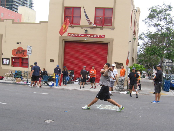Six teams from California play stickball in Little Italy on a fine summer Sunday.