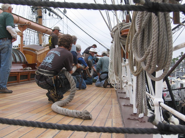 Volunteers pull a huge rope together on the deck of Star of India.