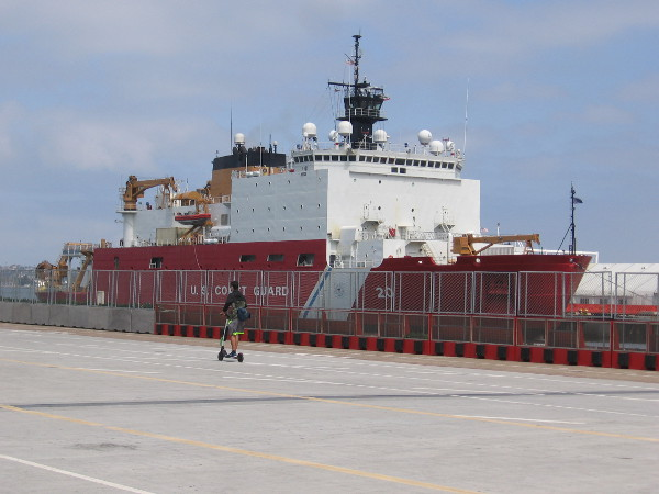 Someone rides a scooter along Broadway Pier past the Coast Guard's newest, most advanced polar icebreaker. I haven't spotted any ice off San Diego!