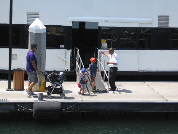 Family boards the Coronado Ferry near Broadway Pier.