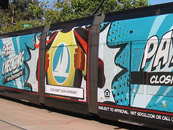A trolley wrap during Comic-Con advertises SDCCU, Your Credit Union Superhero!