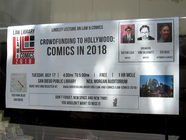 Sign in window of the San Diego Law Library concerns the Lindley Lecture on Law and Comics, which will be held in the Neil Morgan Auditorium of the Central Library during Comic-Con.
