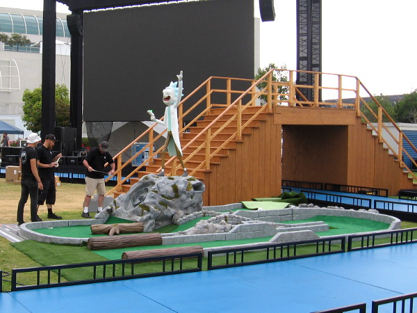 Rick sculpture stands over a miniature golf hole.
