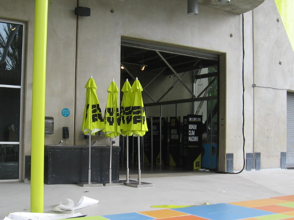 The New Children's Museum has yellow Syfy umbrellas and signs ready, including one for the Human Claw Machine.