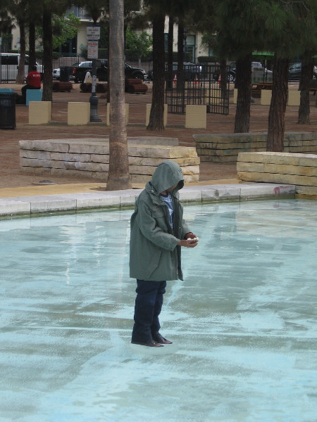 A creepy child mannequin now stands in the Children's Park fountain, with a cage looming among the trees behind him. Part of the Castle Rock offsite.