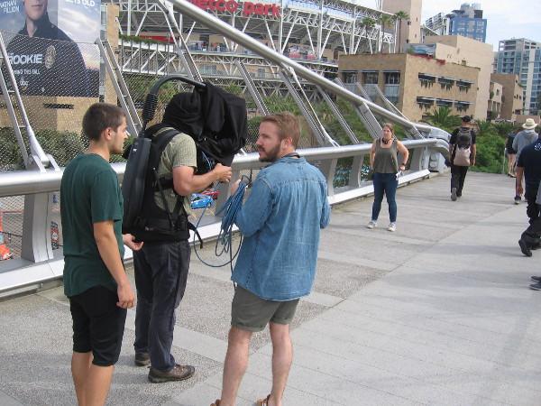 A BBC film crew gets ready to cover 2018 San Diego Comic-Con on the Harbor Drive pedestrian bridge.
