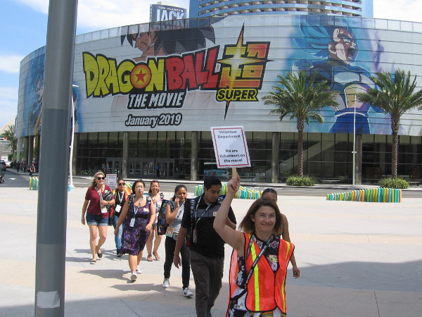 A line of Comic-Con volunteers passes by the afternoon of Preview Night.