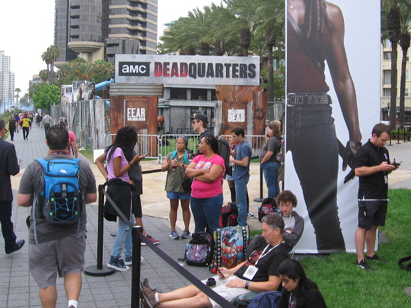 Comic-Con visitors wait in a line near Dead Quarters early Thursday morning.