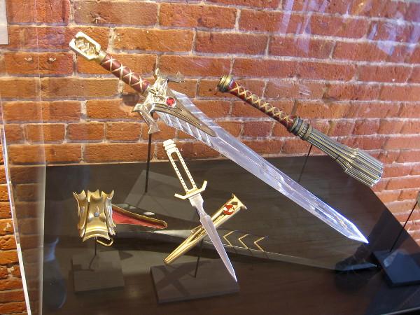 Emperor Georgiou's Imperial Sword and Scabbard, Terran Empire Throwing Disc, Imperial Guard Truncheon.