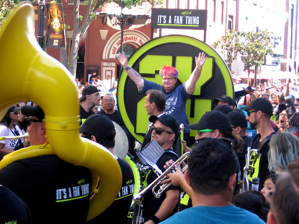 A fan at 2018 Comic-Con receives an award from Syfy in the Gaslamp on Saturday afternoon!