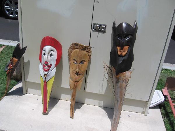 Fun pop culture palm frond art. I recognize Ronald McDonald and Batman.