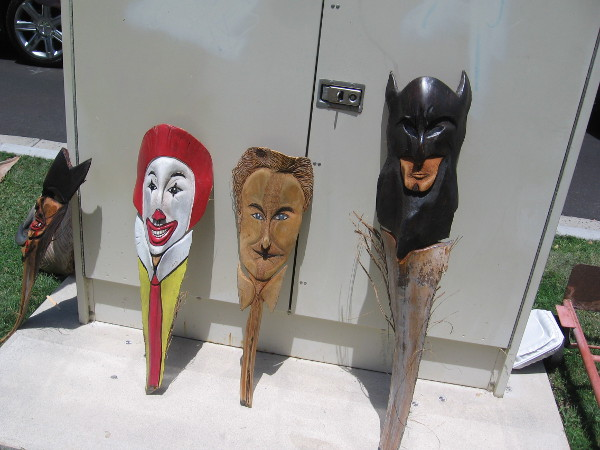 Fun pop culture palm frond art. I recognize Ronald McDonald and Batman.