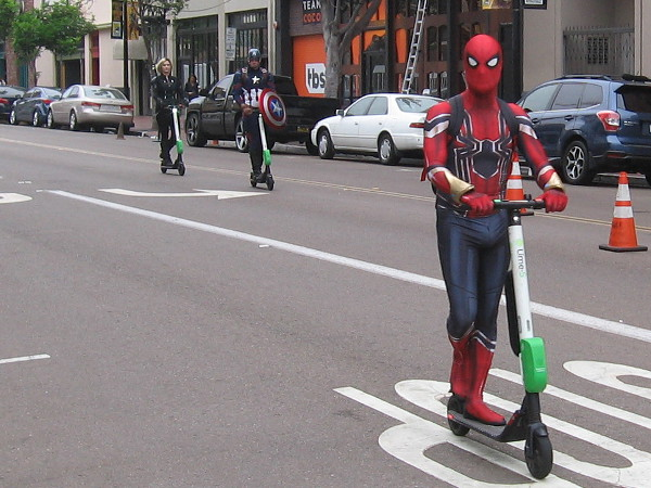 The Avengers' Quinjet must be out of action. Here comes Spiderman, Captain America and Black Widow on scooters!