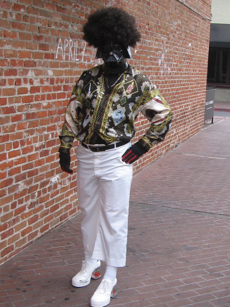 A disco Darth Vader with flashy clothes and an Afro.