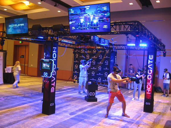 Multiple players enjoy a team gaming experience inside a Hologate virtual reality system.