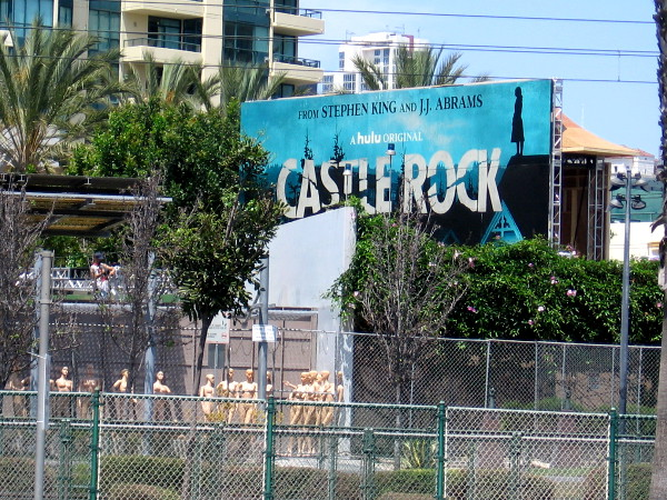 A photo of the Castle Rock sign from across Harbor Drive.