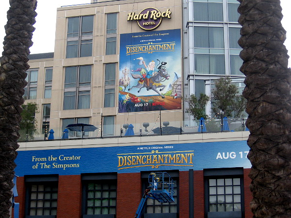 A couple of building wraps promoting Disenchantment on Netflix are being applied to the Hard Rock Hotel.