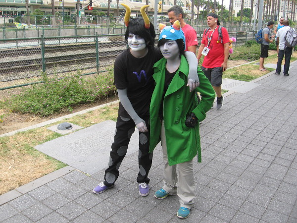 Cosplays of Gamzee Makara and Nepeta Leijon from Homestuck.