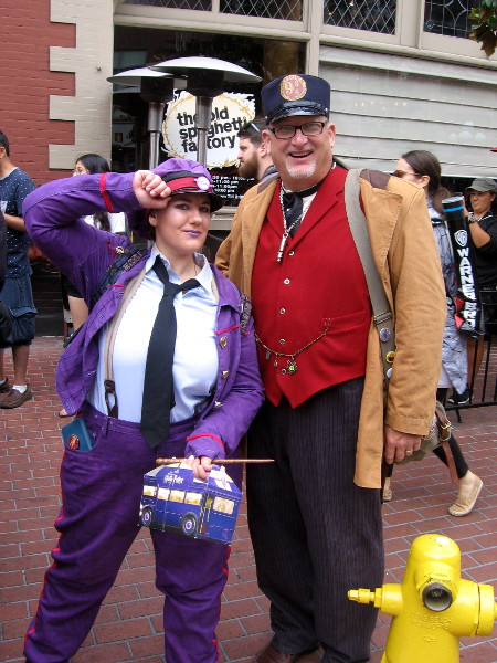Knight Bus conductor and Hogwarts Express conductor cosplay.