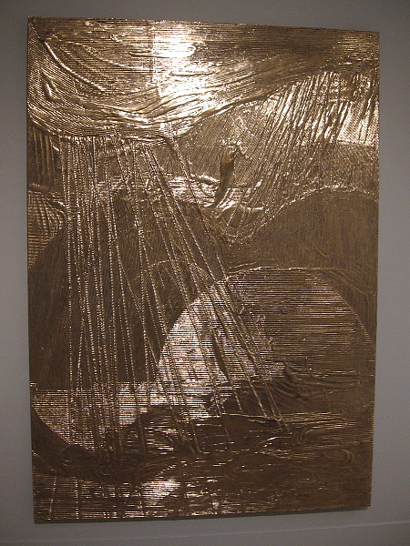 Moon Gold Mountain, Nancy Lorenz, 2018. Moon gold leaf, clay, cardboard, on wood panel.