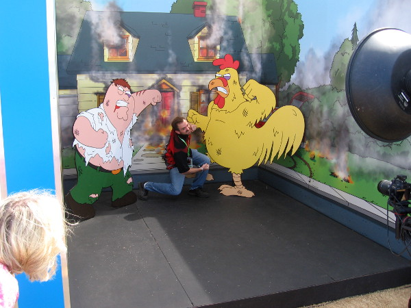 Some poor guy is caught between a fight between Peter Griffin and Ernie the Giant Chicken.