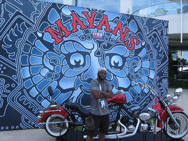 A cool FX guy poses beside a Mayans MC motorcycle for my camera.