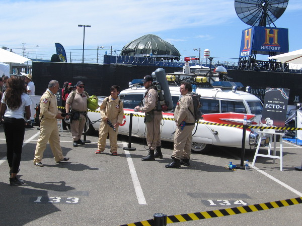 People who line up at Ghostbusters World can have their photo taken next to the original ECTO-1 from the movies.