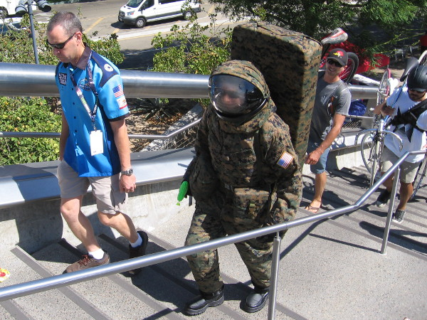 Why would an astronaut in an airless environment need camouflage?