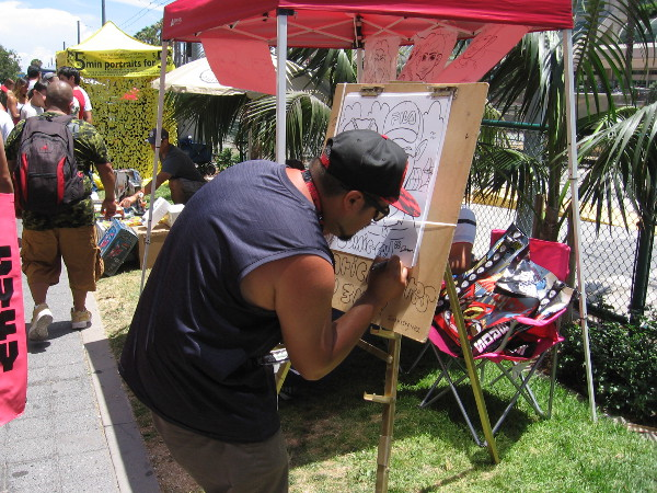 A sidewalk artist creating a fun cartoon.
