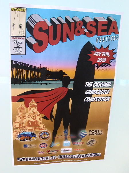 Cool comic book cover! A surfer wears a cape for the 2018 Sun and Sea Festival in Imperial Beach. The original sandcastle competition!