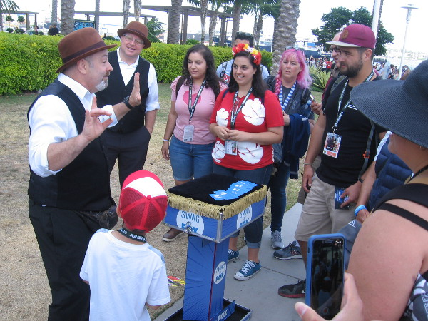 Magicians perform, delighting young and old alike. There's endless magic at Comic-Con!