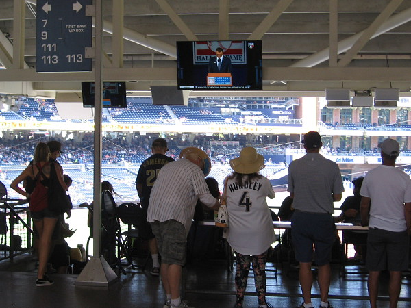 The game will soon start. Trevor's induction speech is repeated on video screens throughout Petco Park.