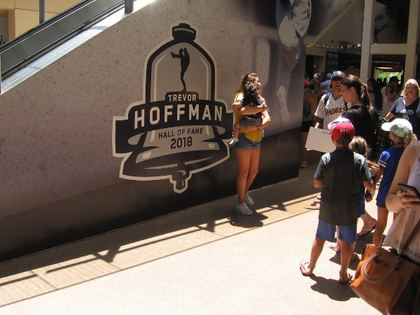 Fans were posing by some new Trevor Hoffman Hall of Fame graphics on a wall along the Petco Park concourse.