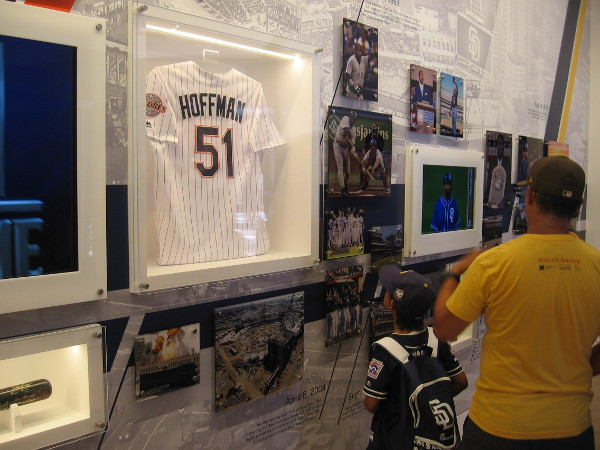 A boy looks up at a Trevor Hoffman jersey in the Padres Hall of Fame.