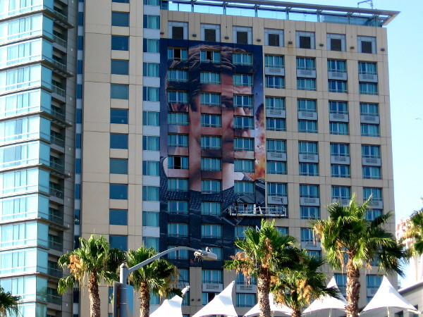 A big building wrap on the Omni Hotel will promote Amazon's upcoming show Tom Clancy's Jack Ryan.