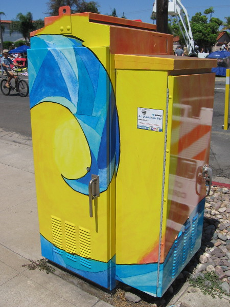 Surf breaks on a utility box. Coronado is not a true island, even if it's almost entirely surrounded by water.